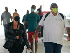 Charlotte Charles (left) and Tim Dunn, the parents of Harry Dunn arrive at Terminal 2 of Heathrow Airport, London, before departing on a flight to the US to give evidence under oath as part of a damages claim against their son???s alleged killer. Picture date: Tuesday June 29, 2021.