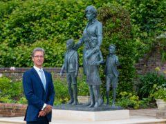 Sculptor Ian Rank-Broadley with his statue of Diana, Princess of Wales (Dominic Lipinski/PA)