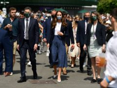 The Duchess of Cambridge makes her way through the grounds during her visit on day five of Wimbledon at The All England Lawn Tennis and Croquet Club, Wimbledon (Adam Davy/PA)