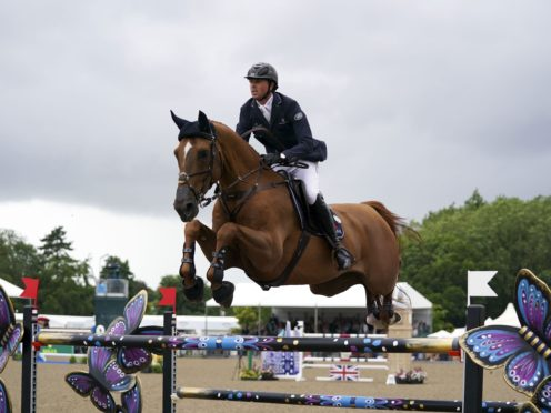 Ben Maher competing at the Royal Windsor Horse Show on Explosion W (PA)