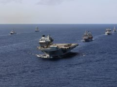China has warned Britain to 'remain restrained and obey the rules' as the Royal Navy's carrier strike group (CSG) sails through the South China Sea (Ministry of Defence/PA)