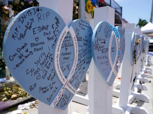 A wooden heart at a makeshift memorial for the victims of the collapse of the Champlain Towers South building (Lynne Sladky/AP)