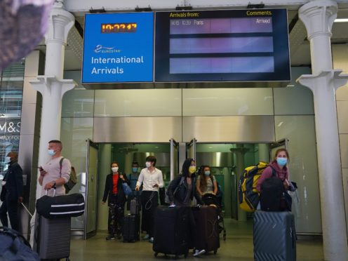 Travellers arriving from France on the Eurostar at St Pancras International railway station in London (Yui Mok/PA)