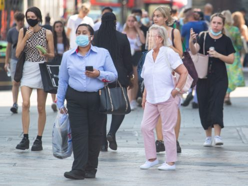 People wearing face masks in central London, after the final coronavirus legal restrictions were lifted in England (Dominic Lipinski/PA)