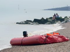 A boat thought to be used in a migrant crossing is left on the beach in Walmer, Kent (Gareth Fuller/PA)