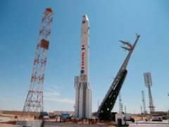 A Proton-M booster rocket carrying the Nauka module stands at the launch pad at Russia's space facility in Baikonur, Kazakhstan (Roscosmos Space Agency Press Service/AP)