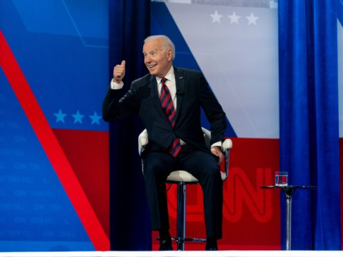 President Joe Biden interacts with members of the audience during a commercial break for a CNN town hall at Mount St Joseph University in Cincinnati (Andrew Harnik/AP)