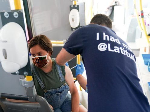 Felicity Perry receives her second dose of a Covid-19 vaccine on board a vaccination bus at the Latitude festival in Henham Park, Southwold, Suffolk (Jacob King/PA)