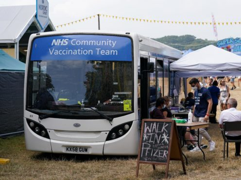 A Covid-19 vaccination bus at Latitude festival in Henham Park, Southwold, Suffolk (Jacob King/PA)
