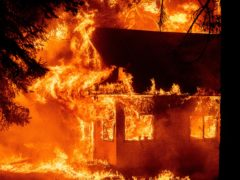 Flames consume a home as the Dixie Fire tears through the Indian Falls community in Plumas County (Noah Berger/AP)