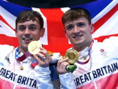 Great Britain's Tom Daley (left) and Matty Lee celebrate with their gold medals (Adam Davy/PA)