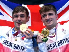 Tom Daley and Matty Lee show off their gold medals (Adam Davy/PA)