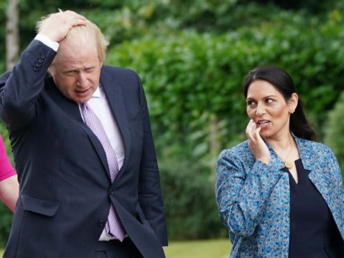 Prime Minister Boris Johnson and Home Secretary Priti Patel during a visit to Surrey Police headquarters to coincide with the publication of the government's Beating Crime Plan (PA)