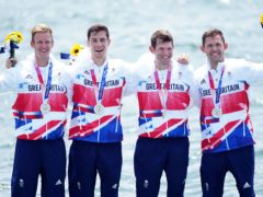 Great Britain's Harry Leask, Angus Groom, Tom Barras and Jack Beaumont collect their silver medals for the Men's Quadruple Sculls during the Rowing on the fifth day of the Tokyo 2020 Olympic Games (PA)
