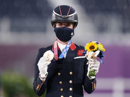 Charlotte Dujardin celebrates winning bronze (Danny Lawson/PA)
