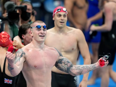 Great Britain's Adam Peaty and James Guy celebrate winning the Mixed 4×100 metres medley relay at Tokyo Aquatics Centre (Joe Giddens/PA)