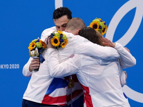 Adam Peaty, James Guy, Anna Hopkin and Kathleen Dawson celebrate their gold (Adam Davy/PA)