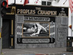 A mural of Alex Higgins in Belfast (Niall Carson/PA)
