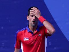 Novak Djokovic shows his frustration during his bronze medal defeat against Pablo Carreno Busta (AP Photo/Seth Wenig)
