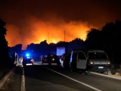 Cars are parked by the road as fires have been raging through the countryside in Cuglieri (Alessandro Tocco/LaPresse via AP)