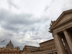 The sky above St. Peter's Square at the Vatican, is overcast, on Tuesday, July 27, 2021. A trial is slated to begin on Tuesday within the Vatican City's imposing walls of 10 defendants, including a once-powerful cardinal, in a case based on a sprawling probe into the allegedly criminal management of the Holy See's portfolio of assets, including donations by countless Catholics from the pews. (AP Photo/Riccardo De Luca)