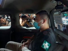Tong Ying-kit arrives at Hong Kong High Court in a police van (Vincent Yu/AP)