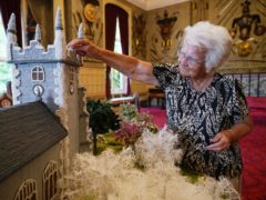 Ninety-two-year-old Margaret Seaman, from Great Yarmouth, with her creation (Yui Mok/PA)