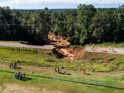 A collapsed section of Highway 26 in the Benndale community, west of Lucedale, Mississippi (Travis Long/The News & Observer via AP)