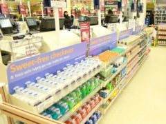 Researchers found that customers make healthier food purchases if sweets and snacks are removed from checkouts and the ends of aisles (Tesco/PA)