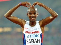 Mo Farah celebrates after winning gold in the Men's 10,000 metres during the 2015 World Championships in Beijing (Adam Davy/PA)