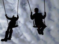 Children enjoy playing on swings in a park near Ashford, Kent (Gareth Fuller/PA)