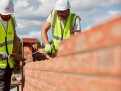 Workers laying bricks at a construction site (Taylor Wimpey/PA)