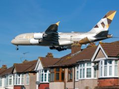 A Etihad Airways Airbus A380 plane comes into land at Heathrow Airport (Steve Parsons/PA)