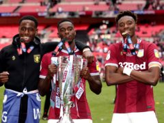 Manchester United defender Axel Tuanzebe, centre, helped Aston Villa reach the Premier League in 2019 and will have a second loan spell at the club (John Walton/PA)