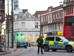 Armed police at the scene in Streatham High Road, south London, after a man was shot dead by armed officers (Victoria Jones/PA)