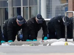 Police conduct a finger tip search following the terror attack in Streatham High Road, south London by Sudesh Amman, 20, who was shot dead by armed police following what police declared as a terrorist-related incident (PA)