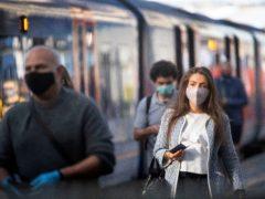 Masks remain mandatory on trains (Victoria Jones/PA)