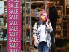 A shopper on Buchanan Street in Glasgow. The city is performing better than others (Andrew Milligan/PA)