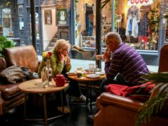 People enjoy a breakfast and coffee in Cardiff (PA)
