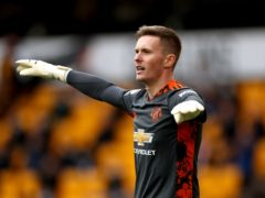 Manchester United goalkeeper Dean Henderson will miss the club's training camp in Scotland due to the after-effects of Covid-19 (Bradley Collyer/PA)