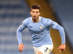 Ruben Dias, pictured, has signed a new long-term contract at Manchester City (Martin Rickett/PA)