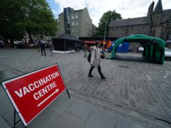 A drop-in vaccination bus run by Scottish Ambulance Service and NHS Lothian at the Grassmarket in Edinburgh (Andrew Milligan/PA)