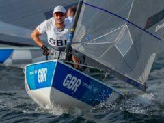 Giles Scott claimed a dramatic gold medal in the Finn class (Bernat Armangue/AP)