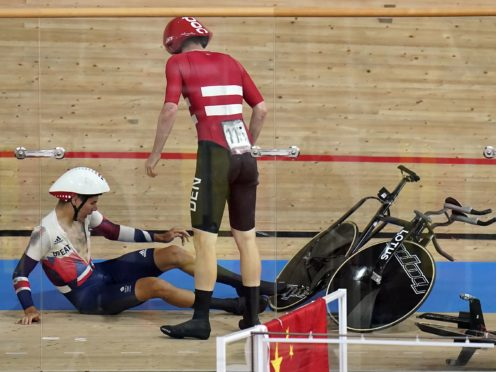 Great Britain's Charlie Tanfield lies on the track after being shunted off it by Denmark's Frederik Madsen in the men's team pursuit (Danny Lawson/PA Images).