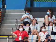 Great Britain's Tom Daley knits in the stands during the men's 3m springboard final (Martin Rickett/PA)