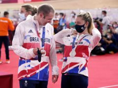 Laura and Jason Kenny with their silver medals (Danny Lawson/PA)