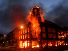 Fire rages through a building in Tottenham, north London during the riots of 2011 (PA)