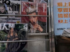 A magazine cover featuring Chinese-Canadian pop star Kris Wu (centre (Ng Han Guan/AP)