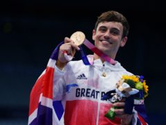 Tom Daley with a bronze medal (PA)