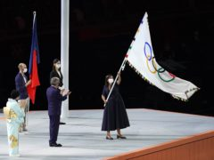 The Olympic flag is handed over by IOC president Thomas Bach to Paris mayor Anne Hidalgo during the closing ceremony of Tokyo 2020 (Martin Rickett/PA Images).